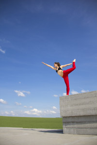 Doing Yoga Outside in Red Pants with Blue Sky